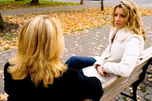 two-women-talking-on-bench (1)