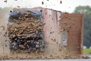 crashing into brick wall